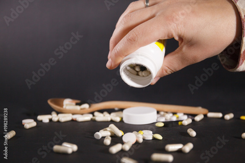 Fotobehang Apotheek Tablets and capsules are scattered on the table