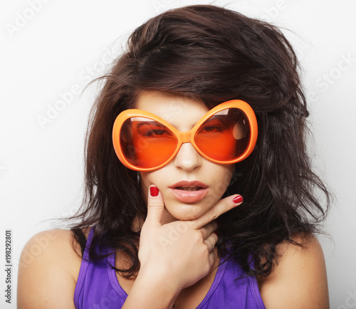 lifestyle and people concept: fashion girl with big sunglasses over white background © Raisa Kanareva