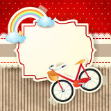 Bike and rainbow on cardboard background