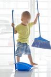 Toddler sweeping floor