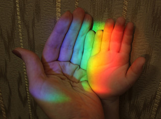 hand of mother and child rainbow