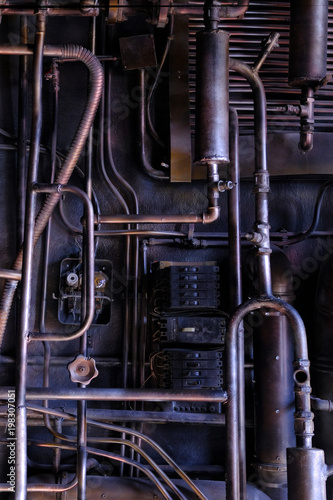 Fotobehang Oude verlaten gebouwen Dark industrial interior with metal rusty old pipes