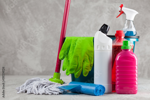 Cleaning supplies on grey background - 198314026