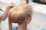 Hairdresser finishing bride's hairsyle