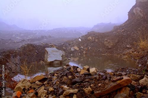 Fotobehang Bruin Rain, puddles and rocks