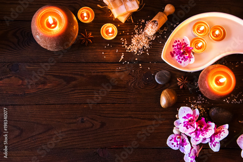 Foto op Plexiglas Spa Spa concept with chocolate and candles on a wooden background.