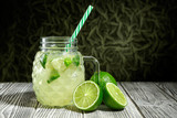 Lemonade in a glass jar with slice of lime