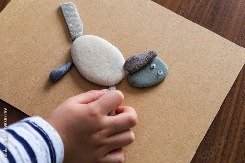 Fotobehang Stenen in het Zand Playing with stones.children's activities. Stones concept.