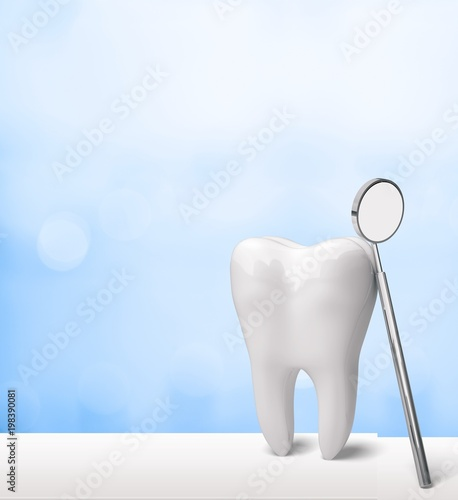 Big tooth and dentist mirror