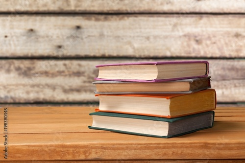Poster Stack books on wooden desk