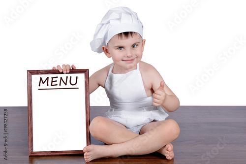 A small cook sits with a menu
