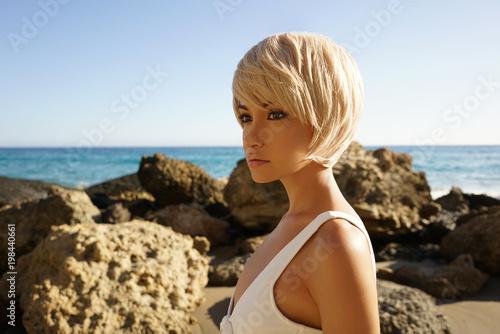 Fotobehang womenART Graceful woman in white swimwear on the beach