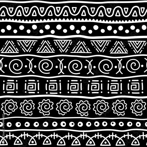 Seamless pattern in ethnic style. Ornamental element African theme. Set of seamless vintage decorative tribal border. Traditional African pattern background with tribal elements form. © Katikam
