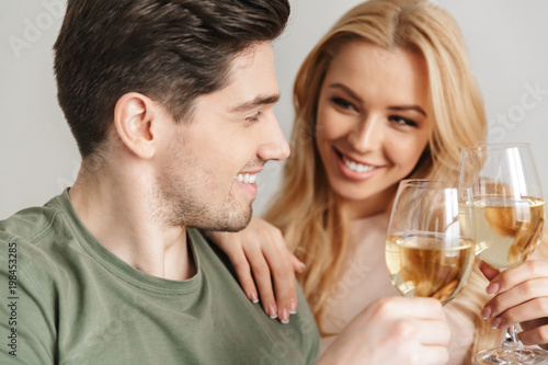 Happy young loving couple drinking alcohol white wine champagne. Poster