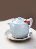 White teapot with tea bag - 198471283