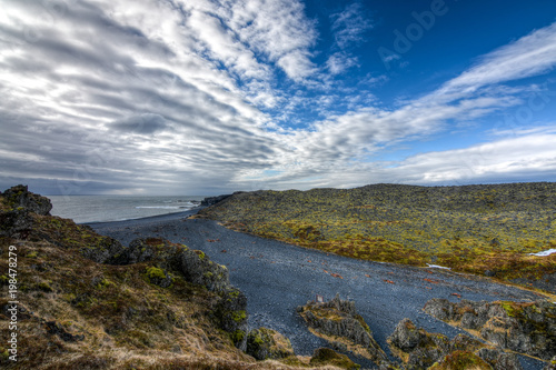 Fotobehang Bleke violet A high view looking down on a black sand beach in Iceland with a dramatic cloudscape