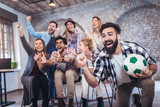 Happy friends or football fans watching soccer on tv and celebrating victory. Friendship, sports and entertainment concept. - 198495273