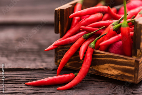 Fotobehang Hot chili peppers Red chili peppers wooden box close