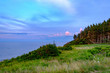 Sunset falls on the forests and wildflowers on the shores of Prince Edward Island and the Gulf of St Lawrence