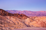 Scenic view from Zabriskie Point, showing convolutions,  color contrasts, and texture in the eroded rock at dawn, Amargosa Range, Death Valley in Death Valley National Park, United States. - 198519233