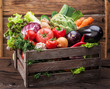 Fresh multi-colored vegetables in wooden crate. Wooden background. - 198520477