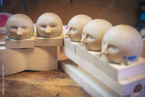 wooden doll heads in toy workshop