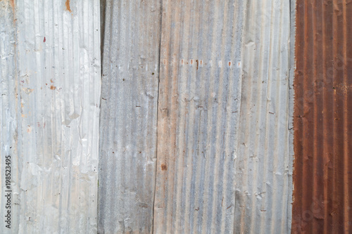 Rusty and corrugated iron metal construction site wall texture background.