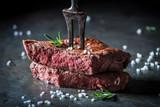 Closeup of medium rare steak with salt and herbs