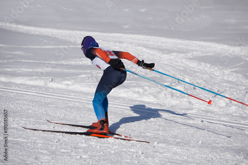 group of male skiers going uphill front view during Championship on cross country skiing
