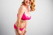 Curvy woman posing in pink underwear
