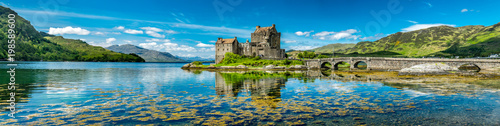 Leinwandbild Motiv Eilean Donan Castle during a warm summer day - Dornie, Scotland