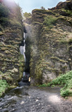 view of a water fall between the rocks
