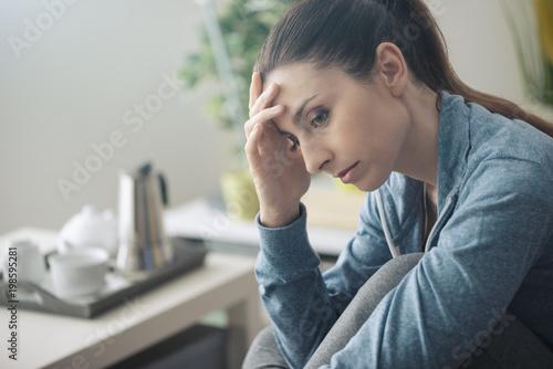 Depressed woman at home