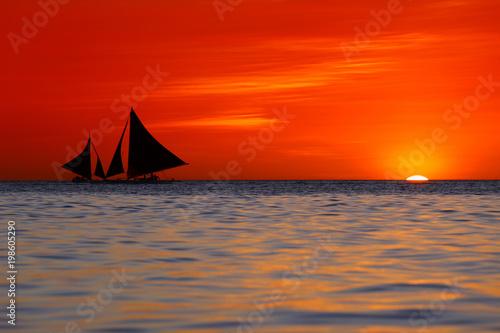 Fotobehang Baksteen Sailing and beautiful red sunset at Boracay Island, Philippines