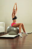 woman doing fitness exercises with fit ball