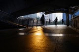 Men walking in the dark