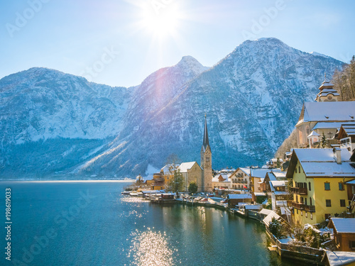 In de dag Blauwe jeans Classic postcard view of famous Hallstatt lakeside town in the Alps moutain ship on a beautiful cold sunny day with blue sky and clouds in winter, Salzkammergut region, Austria