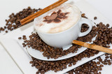 Good Morning: Cup of latte art coffee with coffee beans :) - 198619496