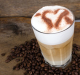Good Morning: Close up white coffee cup on wood tab / Cup of latte art coffee with coffee beans :) - 198620088