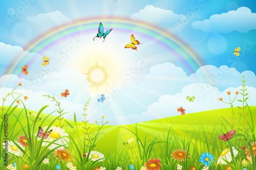 Scena letnia lub wiosenna z zieloną trawą, kwiatami motyli i tęczą