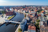 Gdansk, Poland. Aerial skyline panorama with Motlawa river, 4 bridges, Baltic Philharmonic Hall and famous monuments: medieval crane, St Mary, St John churches, city hall tower and old houses
