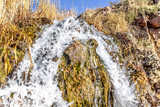 Small waterfall as autumn background
