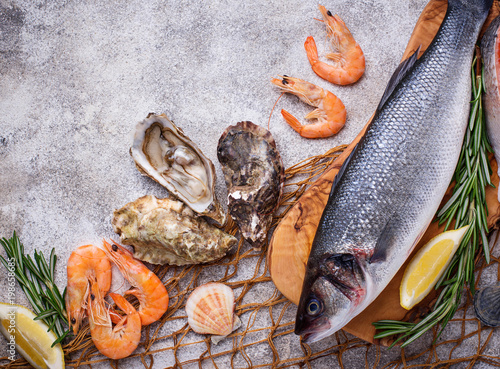 Fototapeta Seafood concept. Fish, shrimps and oysters.