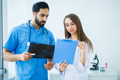 Doctors team examining a patient's x-ray