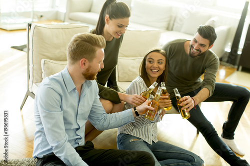 Young people drinking cider and have fun