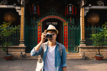 Asian handsome man photographer traveler. Lifestyle concept.