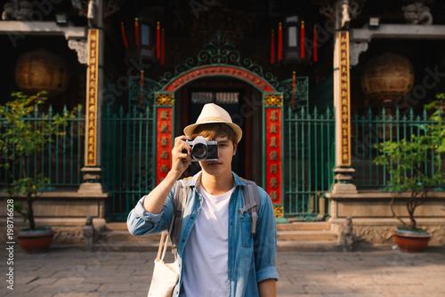 Foto Murales Asian handsome man photographer traveler. Lifestyle concept.