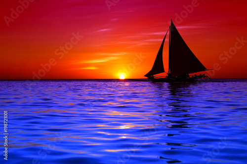 Foto op Canvas Zee zonsondergang Sailing and beautiful red sunset at Boracay Island, Philippines