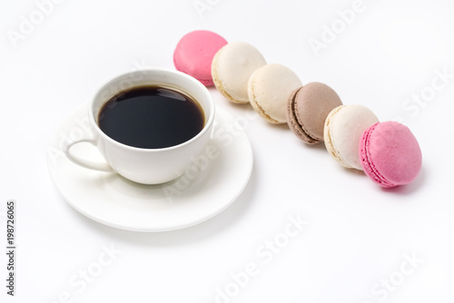 Fotobehang Macarons Cup of Black Coffee and Colorful Macaron on White Background Top View Flat Lay Style Sweet Macaroons