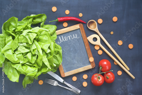 Food ingredients, kitchen utensils,black board for menu, top view, copy space